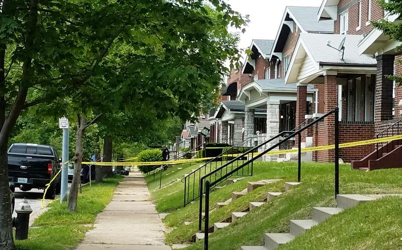 Crime scene investigators with the St. Louis Police Department work a scene in the 3600 block of Wilmington Avenue, where an officer shot and killed a woman on May 10, 2017.