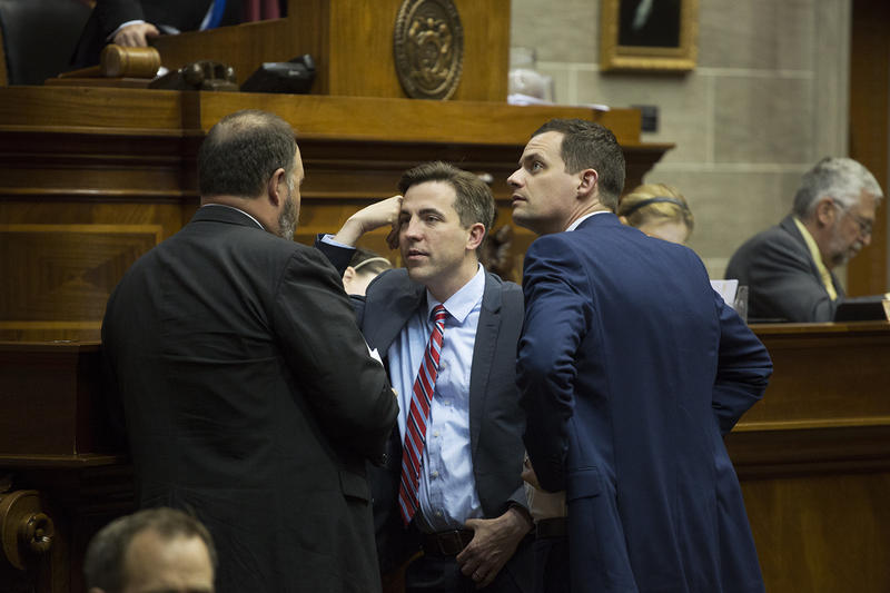Republican state Reps. Jay Barnes, center, and Justin Alferman, right, converse with Alex Curchin, left, during the last day of the Missouri General Assembly's 2017 legislative session.