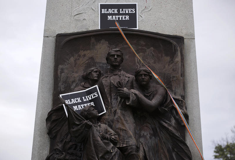 Black Lives Matter posters were placed on the Confederate monument in Forest Park on Tuesday, May 23, 2017.
