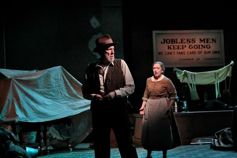 "In this May 24, 2017 photo, Robert Orth as Uncle John and Katharine Goeldner as Ma Joad tangle with each other in ""The Grapes of Wrath."""