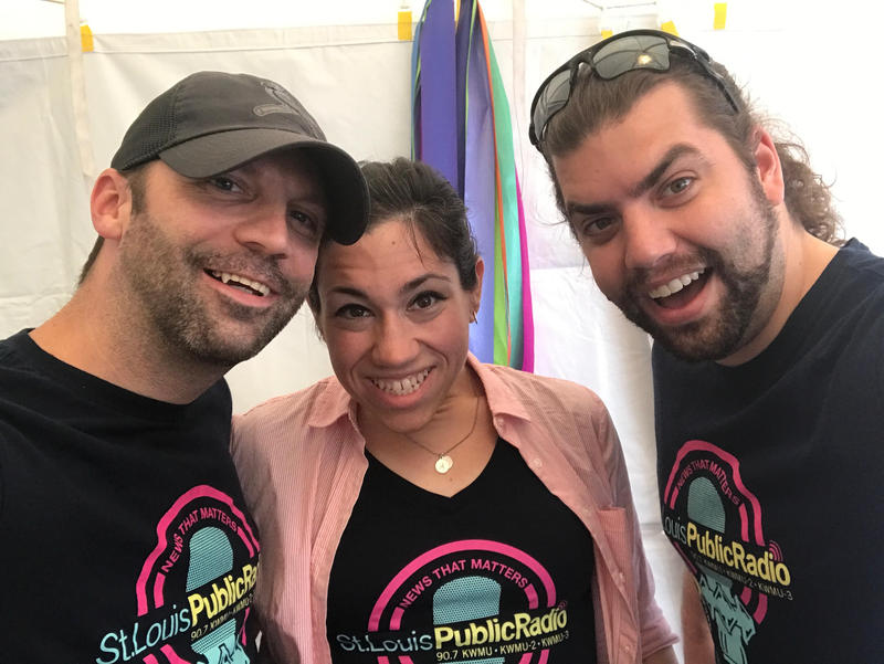 Staff members David Kovaluk and Jennifer Brake (with her husband, Bryan) show up in the same shirt (designed by David!) at Art on the Square in Belleville, IL