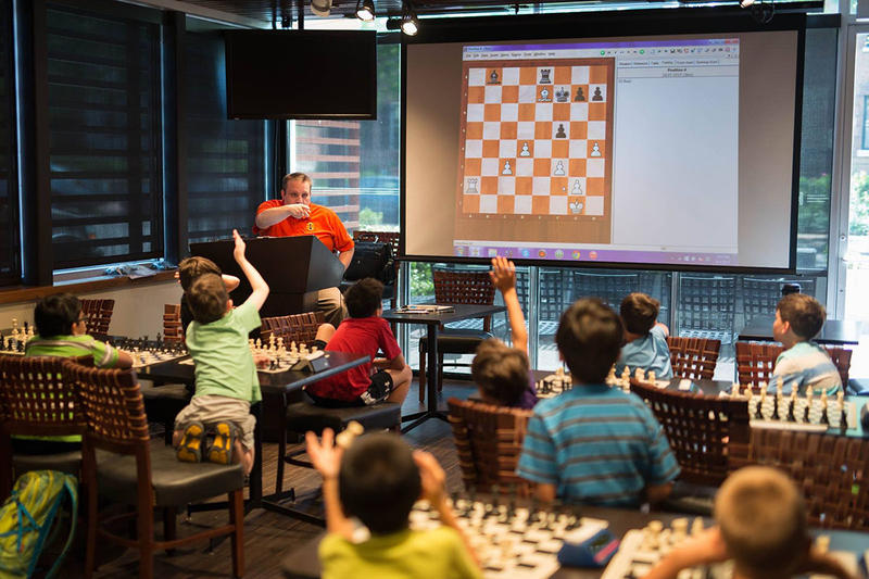 Students eagerly participate during summer camp at the Chess Club and Scholastic Center in 2016.