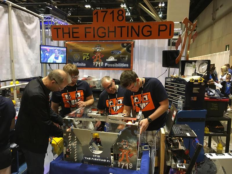 Participants in FIRST Robotics tinker with their machine last week at America's Center. The robotics competition is moving to Detroit next year.