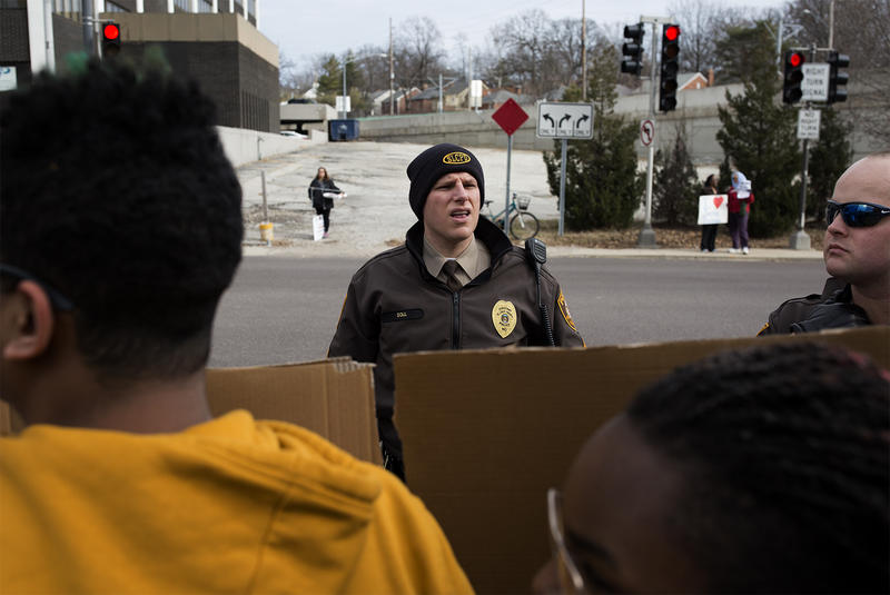 St. Louis County officers join Clayton police in Februrary at a protest outside of Sen. Roy Blunt's office in downtown Clayton.