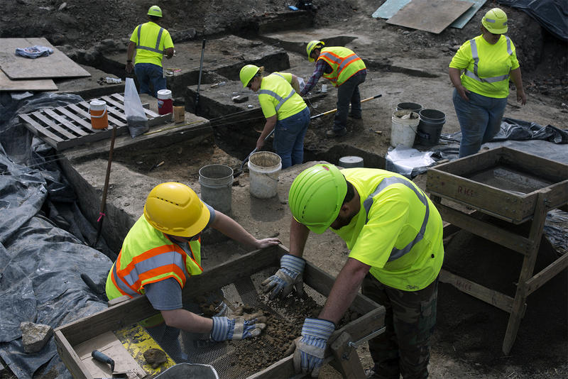 Archaeologists with the Missouri Department of Transportation work near the Poplar Street Bridge in downtown St. Louis in April.