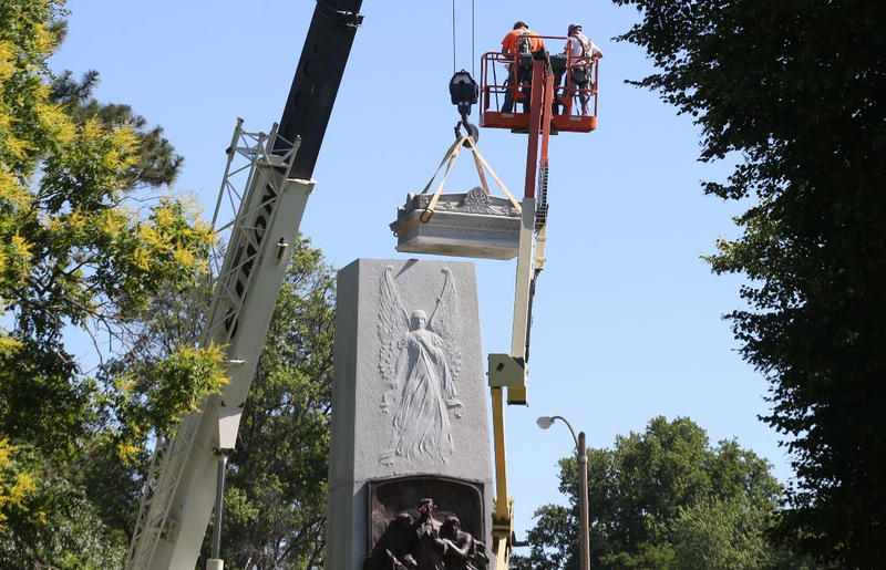 A crane lifts the top off the Confederate Memorial in Forest Park on Thursday, June 8, 2017. A spokesman for Mayor Lyda Krewson says it will take a while to remove the entire piece.