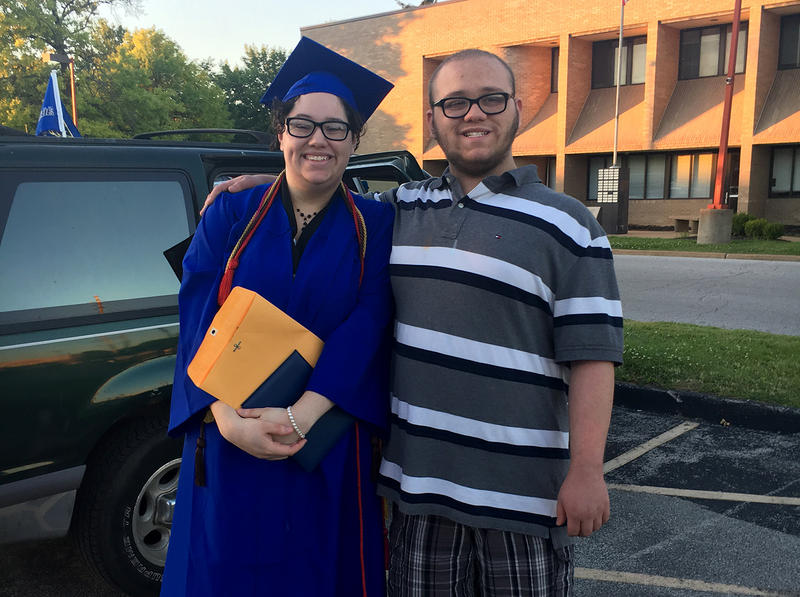 Olivia Stevens pauses for a photo with her brother Alex at her high school graduation May 2017.