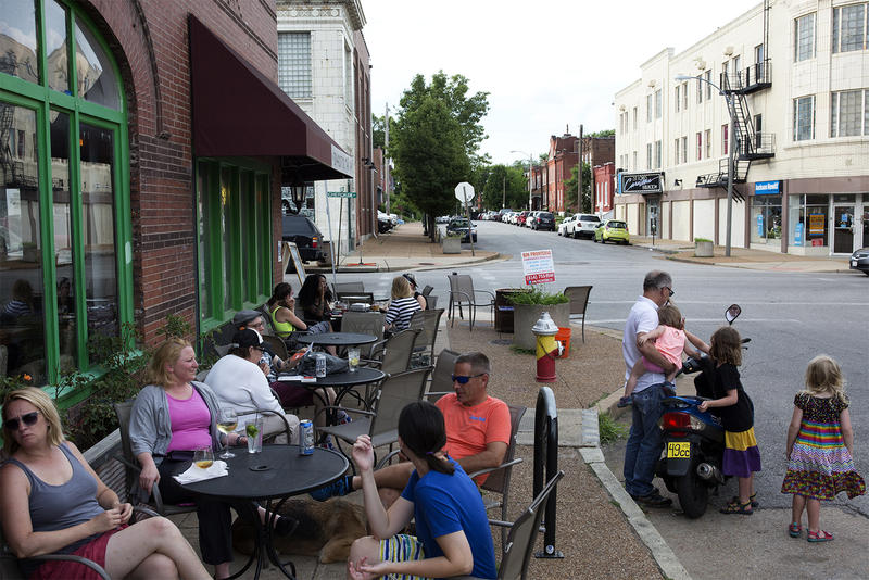 Patrons sit on Iowa Street outside Yaquis on Cherokee.