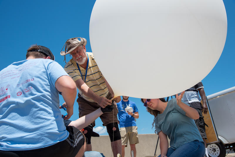 Saint Louis University Robert Pasken and his graduate student Melissa Mainhart perform a test run of a weather balloon that they plan to launch during the Aug. 21 total solar eclipse.