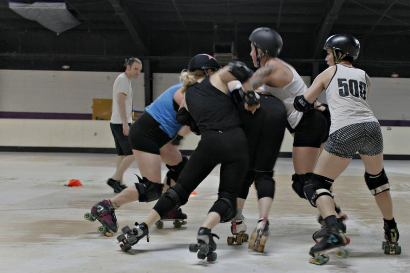 All Stars players run a drill at practice on Monday, June 12, 2017. The team practices in an un-air-conditioned roller rink called the St. Louis Skatium in south city.