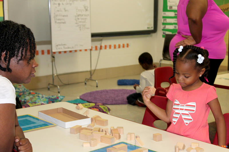 Head Start teacher Chea Wyatt guides Kennydi Harris through an exercise June 23, 2017 at the East St. Louis Kindergarten readiness camp.