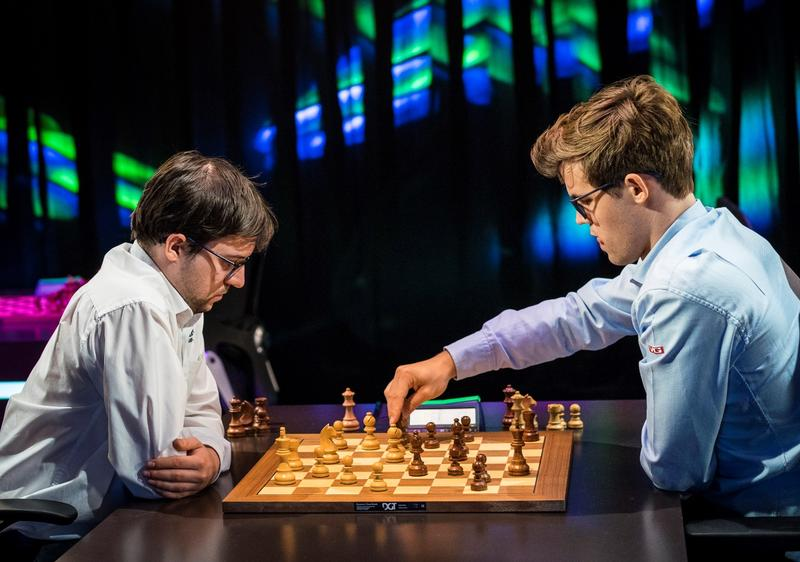 Maxime Vachier-Lagrave (left) studies World Champion Magnus Carlsen move in the playoff in Paris. June 2017