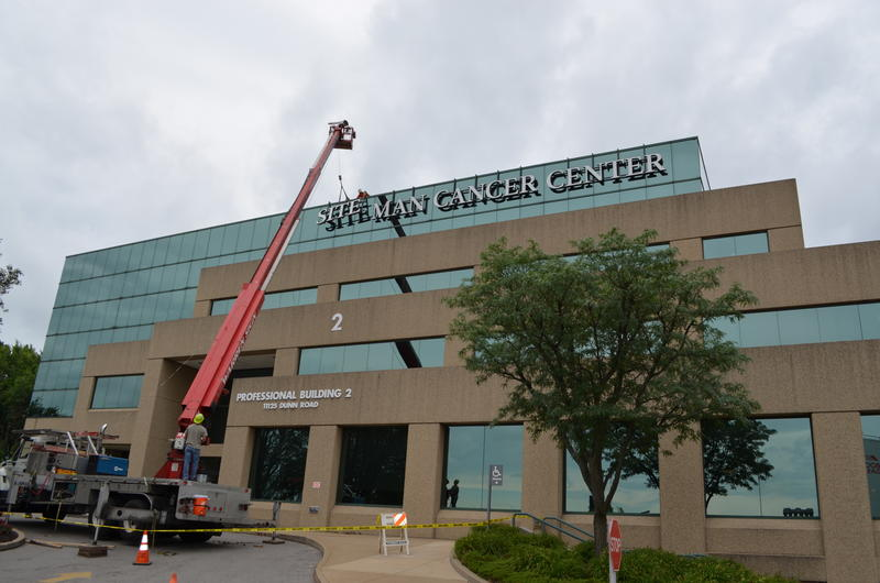 Contractors changed the sign for Siteman Cancer Center on June 30.