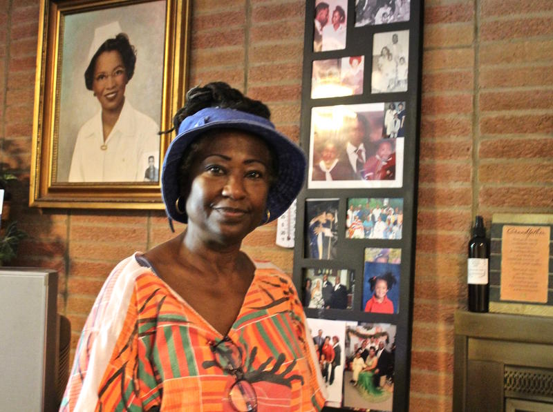 Historian Anne Walker is surrounded by family photos in the living room of her home in East St. Louis. June 2017