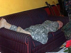 Soldier sleeps in a couch at the USo in Lambert Airport in 2008 before the place was improved. (300 pixels wide)