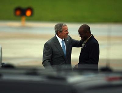 President Bush greets volunteer Jerron Johnson before giving him the President's Volunteer Service award, the highest award for service, at St. Louis Lambert airport on Friday. (300 pixels 2008)