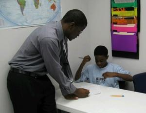 Teacher Ricky Presberry works with a student at the KIPP Kansas City school