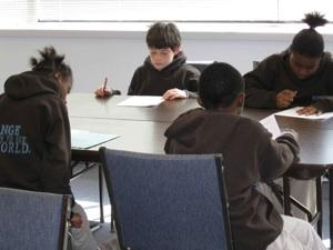 KIPP students in Kansas City work quietly at tables.