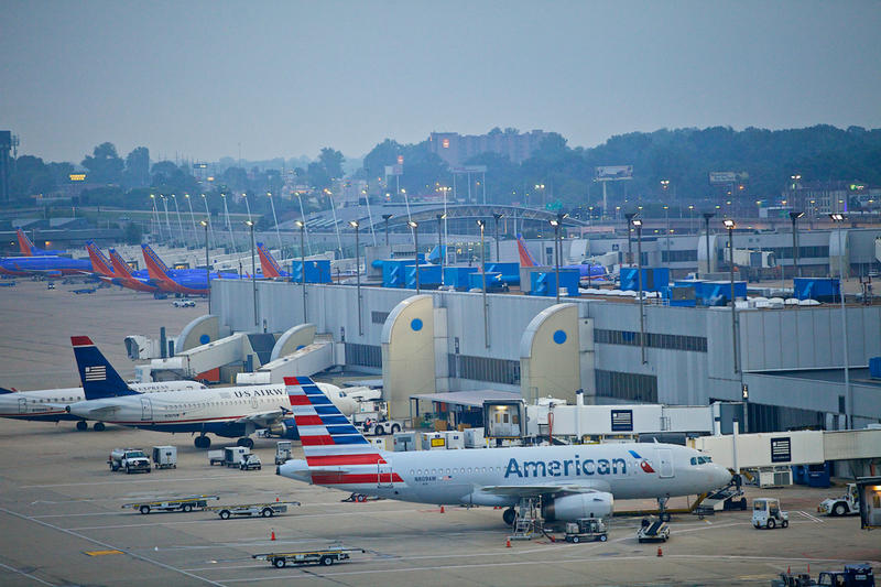 Commerical planes parked at a St. Louis Lambert International Airport terminal.