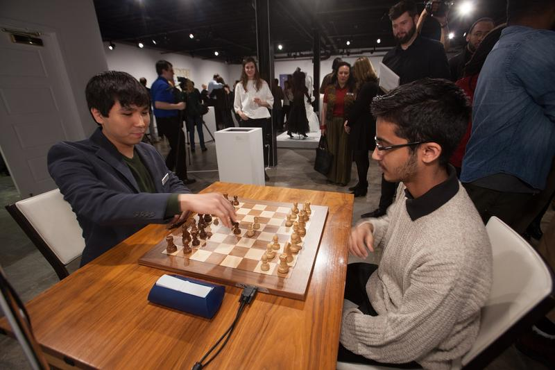 Wesley So and Akshat Chandra playing at the opening reception of The Imagery of Chess: Saint Louis Artists on March 23, 2017.