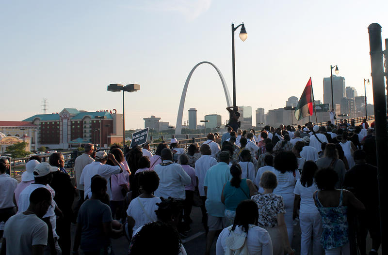 Just as thousands of African-Americans fled the violence during the 1917 race riot, anniversary participants crossed the Eads Bridge to St. Louis Sunday, July 2, 2017.