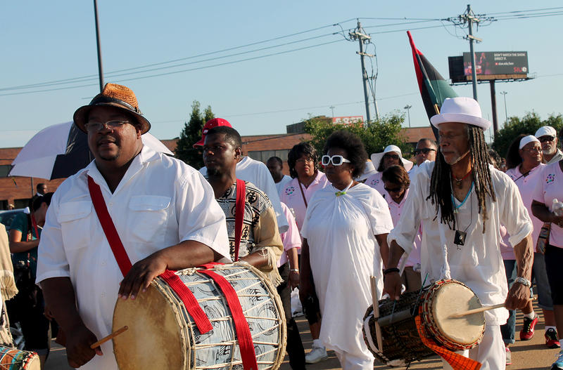 Drummers lead participants through East St. Louis to remember the 1917 race riot on July 2, 2017.