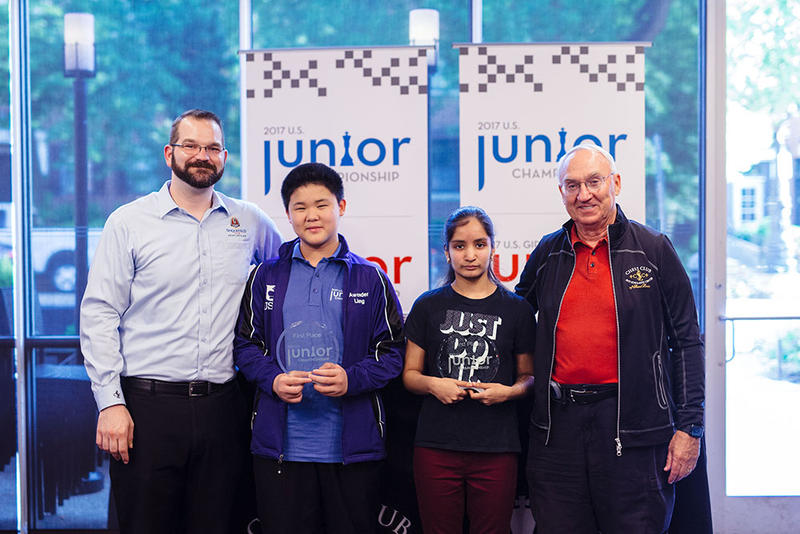 The 2017 U.S. Junior Champion, IM Awonder Liang, and 2017 U.S. Girls' Junior Champion, WIM Akshita Gorti pose for a picture with Chess Club executive director, Tony Rich (L) and Chess Club founder, Rex Sinquefield.