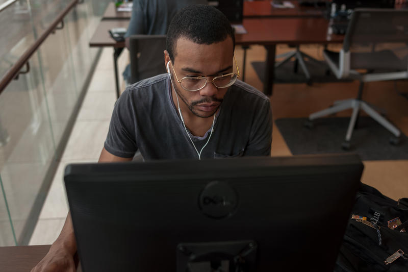Terry Johnson, 25, uses a computer at St. Louis Public Library's central branch on Thurs., July 20, 2017. Starting in October, students will be able to use computers like this one to obtain an online high school diploma