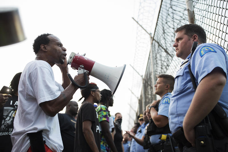 Protesters demand change as those being kept inside St. Louis' Workhouse live without air conditioning during an excessive heat warning in July.