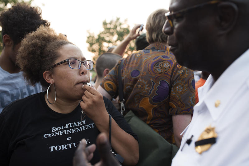 Activist Alicia Street blows a whistle while protesting conditions at the St. Louis Workhouse. July 21, 2017