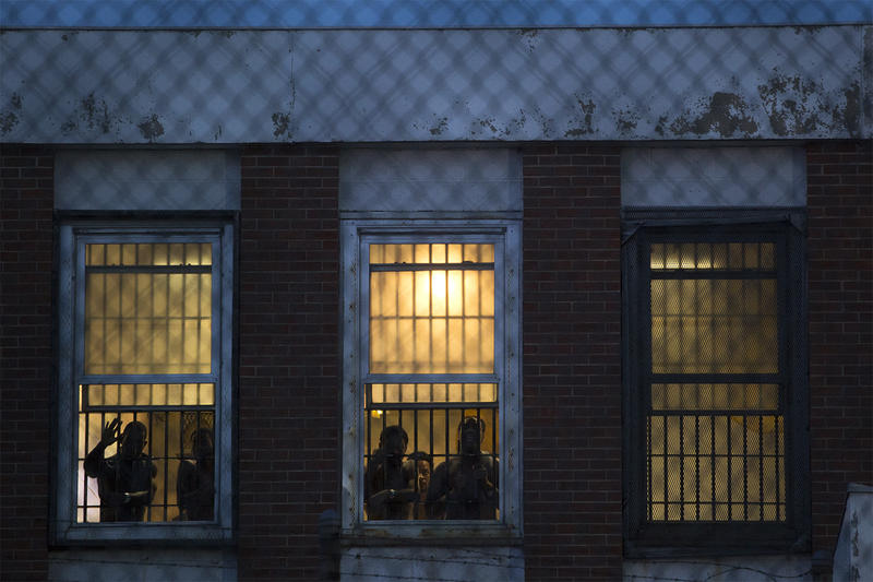 People inside the Workhouse look out as protesters face off with St. Louis police officers. July 21, 2017.
