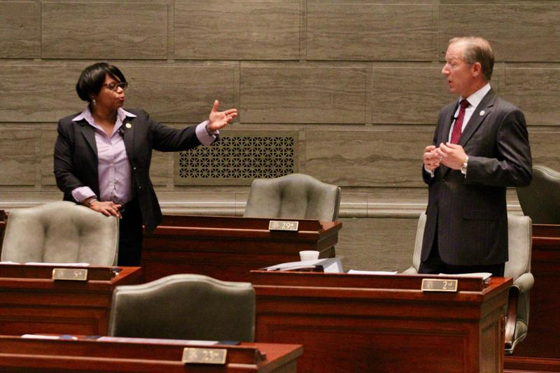 Sen. Jamilah Nasheed, D-St. Louis, and Sen. Bob Onder, R-Lake St. Louis, discuss abortion regulations on the Senate floor on Tuesday.