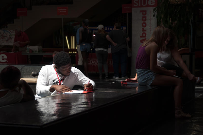 William Thomas, 18, of Chicago Heights, Illinois, fills out residential housing paperwork at a Southern Illinois University-Edwardsville freshman orientation on Friday, July 28, 2017.