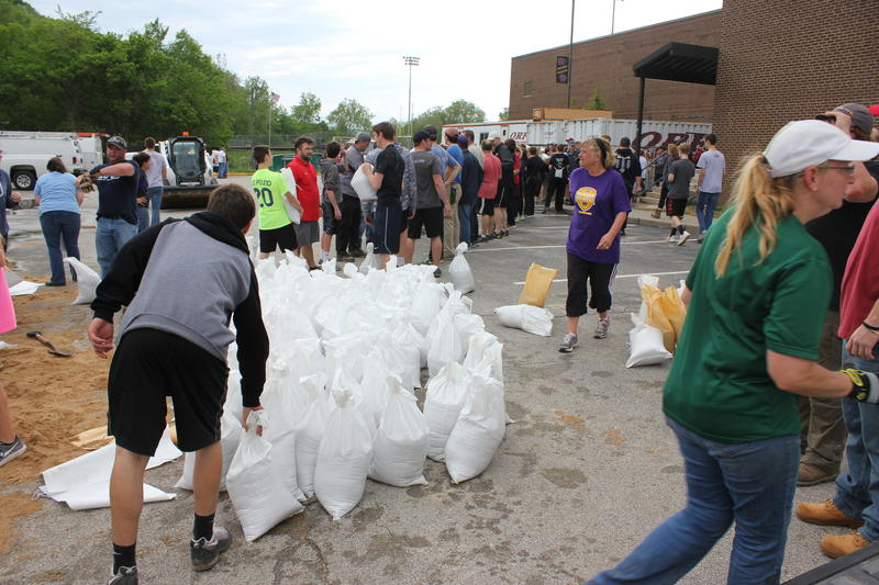 Eureka residents fill sandbags outside Eureka High School in April in preparation for the Meramec River's rising waters. Flooding this spring caused about $1.5 million in damage to the school, according to the district.