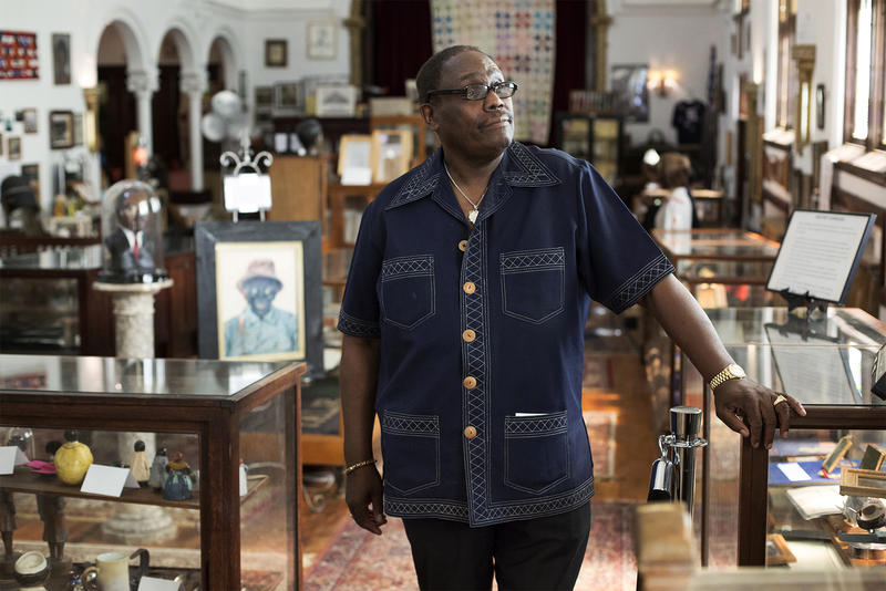 Calvin Riley stands in one of the many rooms of the  George B. Vashon African-American Museum on St. Louis Avenue. (July 2017)