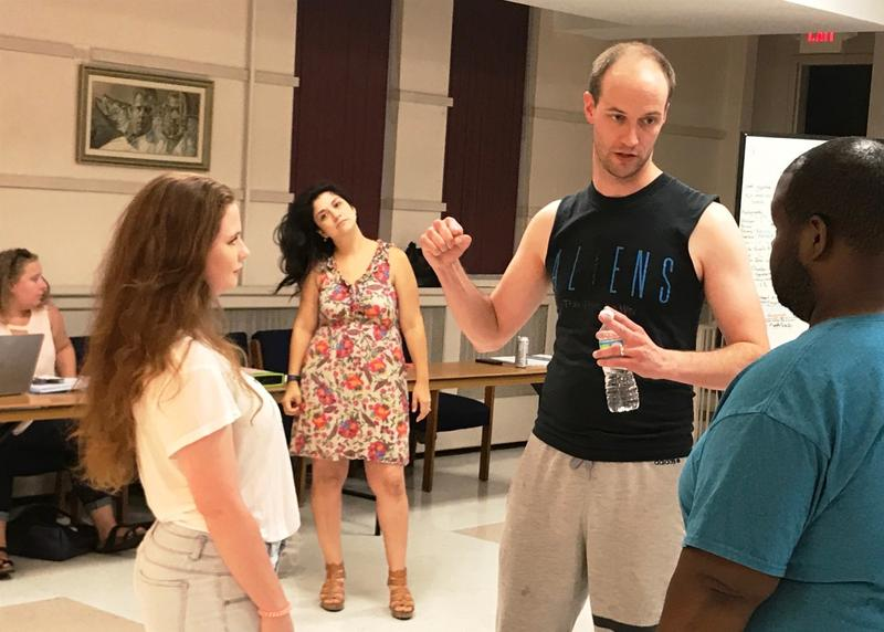 "July 27 photo: Mark Kelley helps cast members of ""In the Heights"" stage a fight while Christina Rios looks on from behind him."