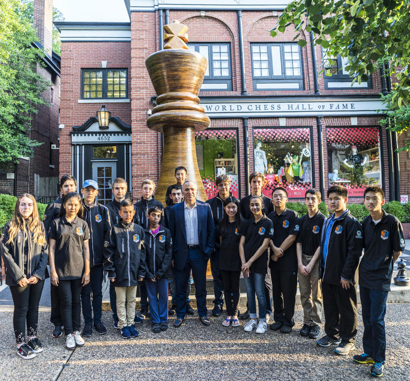 Former world champion Garry Kasparov and members of the U.S. and world youth chess teams.