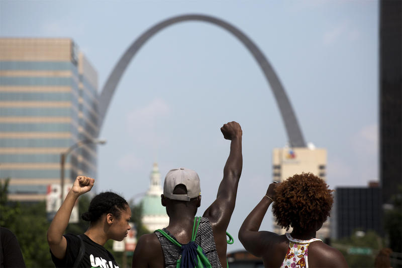 People protest against the criminalization of poverty in downtown St. Louis in on July 21, 2016.