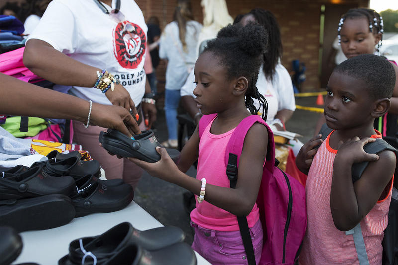Children received free backpacks and shoes at the Korey Johnson Foundation's Can Skate night.