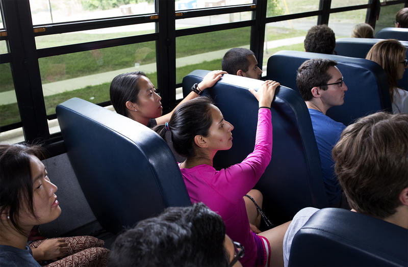 Students listen to a recording at the start of the bus trip.