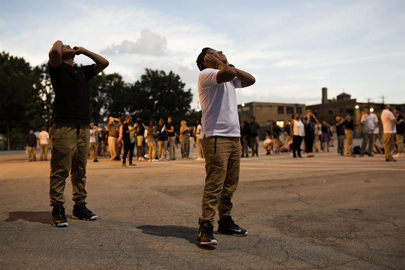 Students at Long International Middle School in St. Louis look up at the eclipse just before totality.