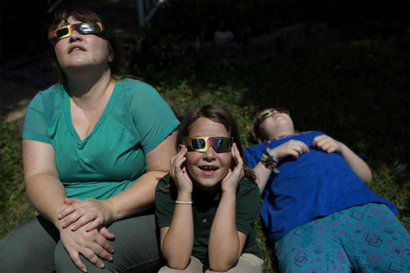 Lydia Orear watches the eclipse with her children, Eva, 8, and Luca, 12, in south St. Louis.