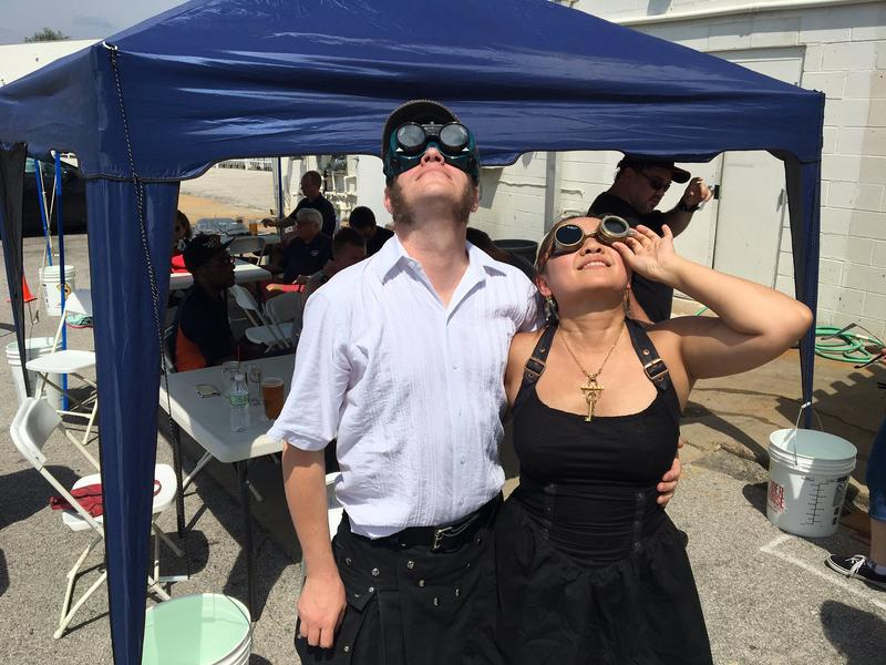 Two eclipse chasers at Steampunk Brew Works in Town and Country retrofitted steampunk-style glasses wtih welder's lenses to view the eclipse.