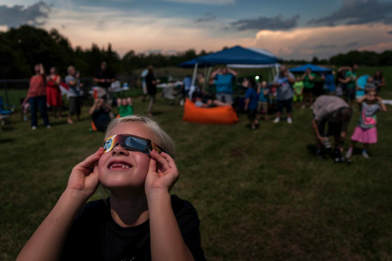 Clarey Huck, 7, waits to be able to take her glasses off just before totality in De Soto, MO. Aug. 21, 2017