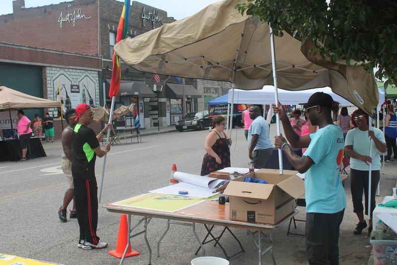 Organizers of the Black Pride Festival set up a tent on Sunday in St. Louis' Grove neighborhood.
