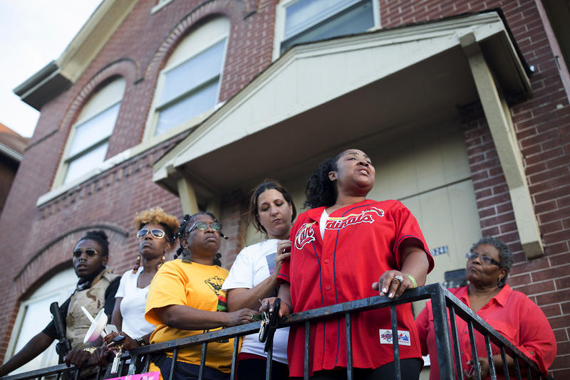 Crevonda Nance, Herring's sister-in-law, is supported by community activists – including Gina Torres, to the left of her, whose son was killed by police in June. Nance drove to St. Louis from Mississippi after finding out Herring was killed by police.
