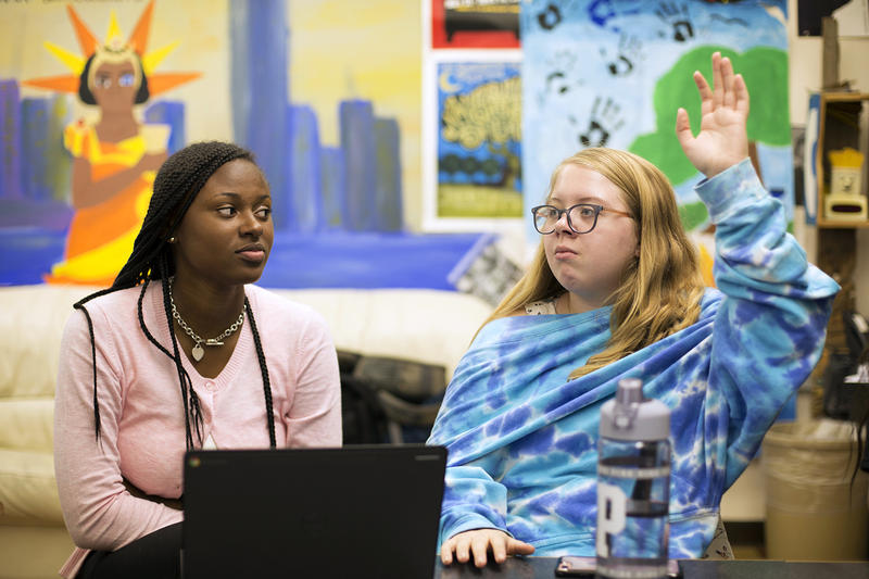 Affton High School seniors Malahja Smith (left) and Isabella Millen participate in a discussion in their cultural studies class, Other Voices, Other Rooms on Aug. 23, 2017.