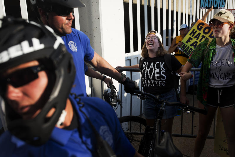 Protesters stand against a barricade surrounding Westboro Baptist Church members as St. Louis police push them to clear a path for the anti-gay demonstrators. Aug. 25, 2017