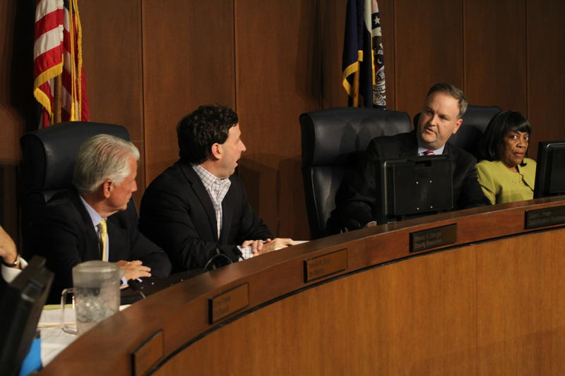 St. Louis County Executive Steve Stenger (second from left) argues with Councilman Sam Page during a meeting of the St. Louis County Council on Tuesday, Aug. 29, 2017. Page sponsored a bill halting construction at the site of an ice center.
