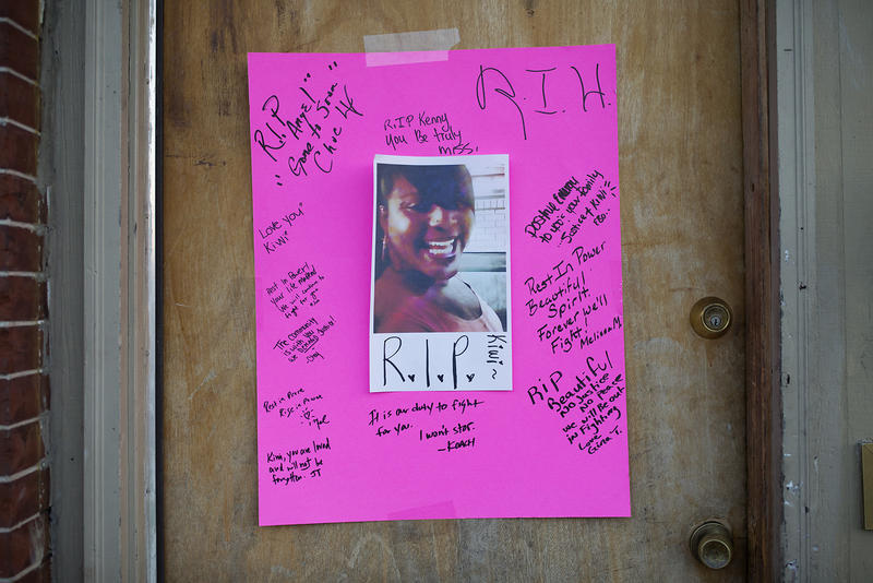 "This pink poster with a photo and scribbled rememberances was hung on the door to the apartment building where Kenneth ""Kiwi"" Herring was shot during police investigation of reported stabbing."